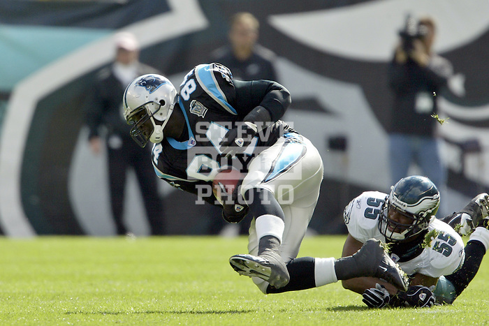 Philadelphia Eagles Dhani Jones (55) tackles Carolina Panthers Michael Gaines (84) during a game against the Panthers in Philadelphia, Penn.  The Eagles beat the Panthers 30-8 and are 5-0 so far this season..October 17, 2004.
