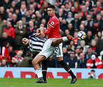 Salomon Rondon of West Bromwich Albion tackled by Chris Smalling of Manchester United during the premier league match at the Old Trafford Stadium, Manchester. Picture date 15th April 2018. Picture credit should read: Simon Bellis/Sportimage