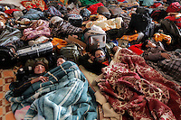 Workers from Thailand sleep in a building on the border.Thousands of people, mainly Egyptian workers, flee unrest in Libya and cross the border into Tunisia. Some slept in the open for several days before being processed. .At the same time forces loyal to Col. Gaddafi fought opposition forces in various parts of the country.