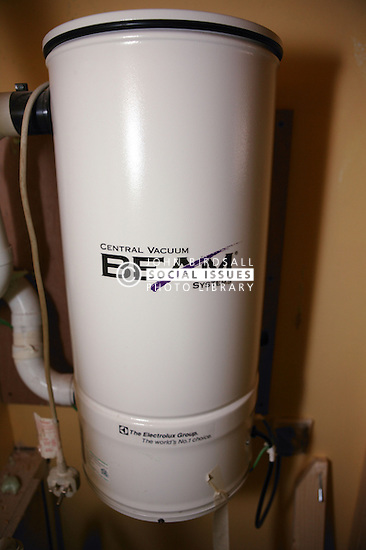 Cylinder of central vacuum cleaning system; designed to expel dust; dirt; mites & pollen from the house; in Eco House at The Wintles; Bishop's Castle,