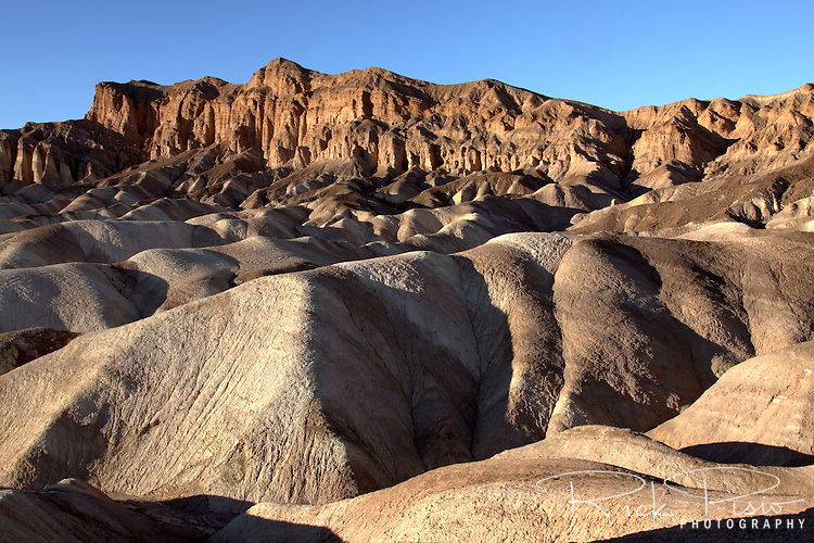 The eroded badlands of Zabriskie Point, in the Amargosa Range near Furnace Creek in Death Valley National Park, is composed of sediments from Furnace Creek Lake, which dried up 5 million years ago, long before Death Valley came into existence.