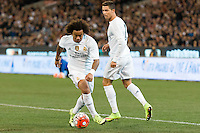 Melbourne, 18 July 2015 - Marcelo Vieira of Real Madrid runs with the ball in game one of the International Champions Cup match at the Melbourne Cricket Ground, Australia. Roma def Real Madrid 7-6 Penalties. Photo Sydney Low/AsteriskImages.com