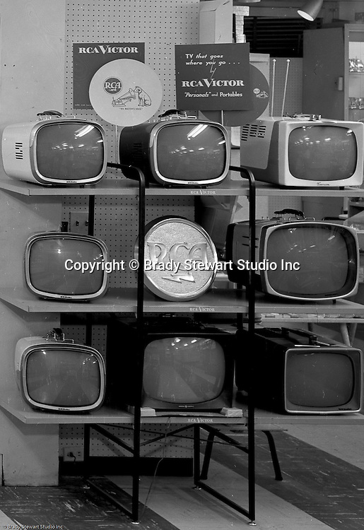 Client: Eiben and Irr Company<br /> Ad Agency:  Eiben and Irr Marketing<br /> Products: Department Store items<br /> Location: Wood Street and Liberty Avenue in Pittsburgh<br /> <br /> Location photography for Eiben and Irr's Holiday Catalog.  RCA B&amp;W and Color Televisions for sale at Eiben and Irr Department Store.  Eiben and Irr Jewelry and Department Store operated in downtown Pittsburgh at the corner of Wood Street and Liberty Avenue from 1953-1979.