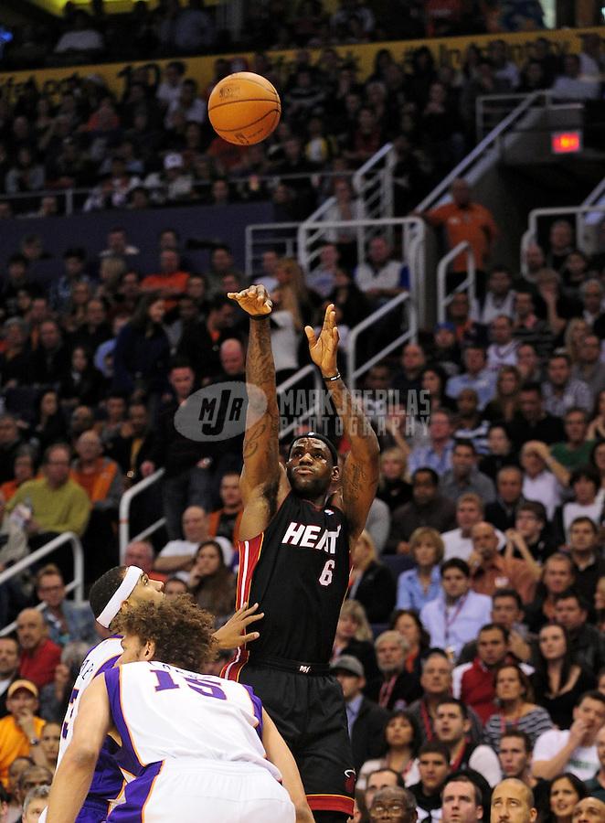 Dec. 23, 2010; Phoenix, AZ, USA; Miami Heat forward (6) LeBron James shoots a shot in the first half against the Phoenix Suns at the US Airways Center. Miami defeated Phoenix 95-83. Mandatory Credit: Mark J. Rebilas-