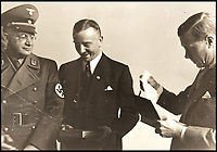 BNPS.co.uk (01202 558833)<br /> Pic: DukesAuctions/BNPS.<br /> <br /> Edward receives a gift from Daimler chairman Dr Wilhem Kissel and the Nazi Gauleiter for the Stuttgart region.<br /> <br /> Remarkable photos of Edward VIII touring a car factory during his controversial visit to Nazi Germany in 1937 have been unearthed.<br /> <br /> Huge crowds turned out to catch a glimpse of the former King, rumoured to be a strong supporter of the Nazi party and the fascist cause, who even walked through a guard of Nazi troops giving Hitler salutes.<br /> <br /> The Duke of Windsor, who had abdicated the previous year, was accompanied by high ranking Nazi party officials and even an SS officer whilst touring the Mercedes-Benz factory in Stuttgart.<br /> <br /> During the trip, the Duke had a private meeting with Hitler at his retreat in Berchtesgaden and was infamously photographed giving Nazi salutes.
