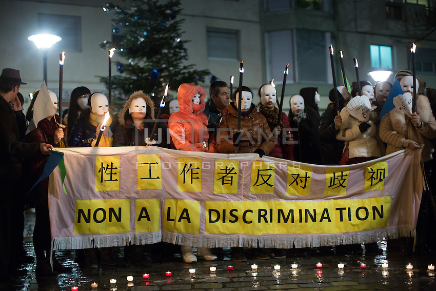 Women of Chinese descent concealed by masks, representing  sex workers in Paris, take part in a demonstration on the International Day to End Violence Against Sex Workers at Place Jean Rostand. Chinese sex workers in Paris, who are usually here without legal papers, often experience violence and harassment on the streets from clients and even police.Paris, France. Dec. 17, 2014