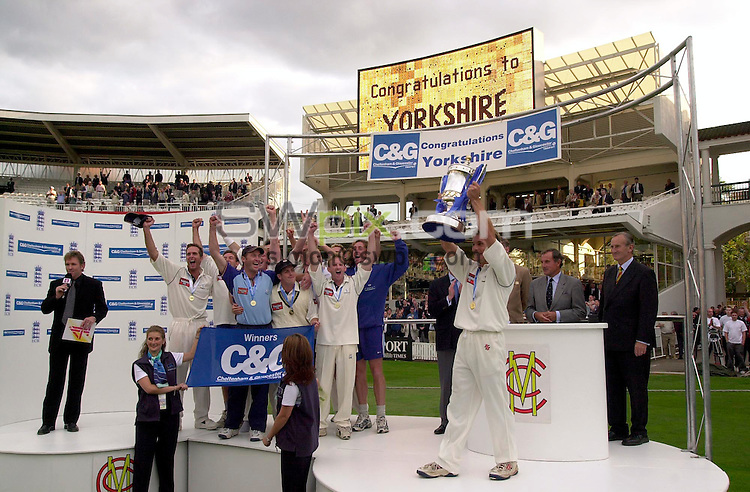 Pix: Ben Duffy/SWpix.com...County Cricket C&G Trophy-Lords, London.....Somerset v Yorkshire....31/08/2002...COPYWRIGHT PICTURE©>>SIMON WILKINSON>>01943 436649>>..Yorkshire's Richard Blakey lifts up the cup as his team celebrate victory over Somerset and winning the C&G Trophy.