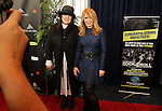 LOS ANGELES, CA - APRIL 18:  Ann and Nancy Wilson of Heart pose for photographs at the 2013 Rock and Roll Hall of Fame Induction Ceremony at the Nokia Theatre in Los Angeles, CA. (Photo by Dave Eggen/Inertia)