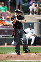 Home plate umpire Jason Johnson calls a batter out on strikes during the Midwest League game between the West Michigan Whitecaps and the Dayton Dragons at Fifth Third Field on May 29, 2017 in Dayton, Ohio.  The Dragons defeated the Whitecaps 4-2.  (Brian Westerholt/Four Seam Images)