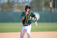 Oakland Athletics catcher Cesare Astorri (12) hustles towards third base during an Instructional League game against the Chicago White Sox at Lew Wolff Training Complex on October 5, 2018 in Mesa, Arizona. (Zachary Lucy/Four Seam Images)