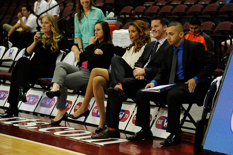 March 6, 2014; Las Vegas, NV, USA; Pepperdine Waves head coach Ryan Weisenberg (second from right) smiles from the bench against the Santa Clara Broncos before the game of the WCC Basketball Championships at Orleans Arena. The Waves defeated the Broncos 80-74.