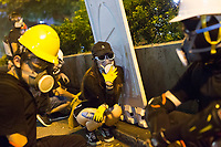 CHINA, Hong Kong: 10 August 2019 <br /> Pro-democracy protesters take cover after riot police fired teargas into a crowd of demonstrators in Tsim Sha Tsui district of Hong Kong. Demonstrators have taken to the streets of Hong Kong in protest of a controversial extradition bill since 9th of June which has resulted in several violent clashes.<br /> Rick Findler / Story Picture Agency