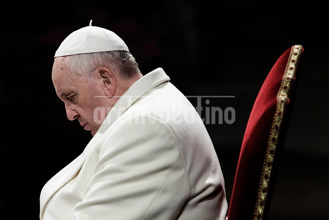 Pope Francis attends the celebration of the Way of the Cross on Good Friday on April 18, 2014 at the Colosseum in Rome