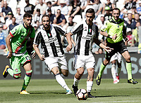 Calcio, Serie A: Juventus vs Crotone. Torino, Juventus Stadium, 21 maggio 2017.<br /> Juventus&rsquo; Paulo Dybala, foreground, in action during the Italian Serie A football match between Juventus and Crotone at Turin's Juventus Stadium, 21 May 2017. Juventus defeated Crotone 3-0 to win the sixth consecutive Scudetto.<br /> UPDATE IMAGES PRESS/Isabella Bonotto
