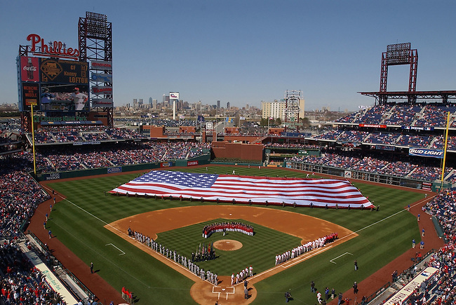 The Washington Nationals and the Philadelphia Phillies line the basepaths during pre-game ceremonies on opening day in Philadelphia, April 4, 2005. The Washington Nationals are playing their first game in Philadelphia after re-locating from Montreal. REUTERS/Bradley Bower