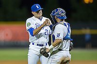 Burlington Royals relief pitcher Anthony Kidston (21) bumps fists with catcher Nathan Esposito (7) after closing out the win over the Princeton Rays at Burlington Athletic Stadium on August 12, 2016 in Burlington, North Carolina.  The Royals defeated the Rays 9-5.  (Brian Westerholt/Four Seam Images)