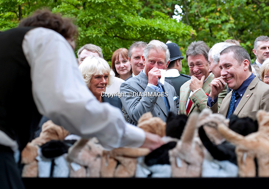 """PRINCE CHARLES  IN TEARS.Prince Charles was reduced to tears as he watched a performance by Henry Dagg on his Organ of Cats, as they toured the garden party in their back garden..They were tears  of joy rather than sadness, brought on by uncontrollable laughter..The Prince of Wales and the Camilla, Duchess of Cornwall hosted """"A Garden Party To Make A Difference"""" at Clarence House, Lancaster House and Marlborough House Gardens, London_10/09/2010.Mandatory Credit Photo: ©DIASIMAGES..**ALL FEES PAYABLE TO: """"NEWSPIX INTERNATIONAL""""**..IMMEDIATE CONFIRMATION OF USAGE REQUIRED:.Newspix International, 31 Chinnery Hill, Bishop's Stortford, ENGLAND CM23 3PS.Tel:+441279 324672  ; Fax: +441279656877.Mobile:  07775681153.e-mail: info@newspixinternational.co.uk"""