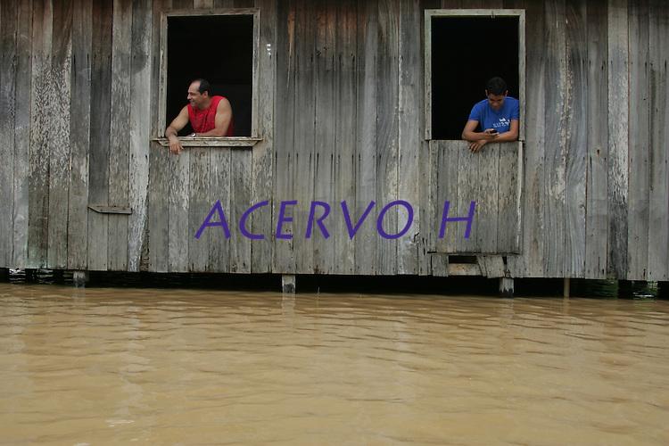 Com 18 bairros embaixo d&aacute;gua e cerca de oito mil casas desocupadas, a enchente no estado do Acre, continua a causar estragos,   o rio Acre registrou hoje a cota de  16,77m   a maior registrada em 2014. As fam&iacute;lias est&atilde;o sendo alojadas no Parque de Exposi&ccedil;&otilde;es. <br /> RIO BRANCO, Acre, Brasil.<br /> Foto Odair Leal <br /> 12/03/2014