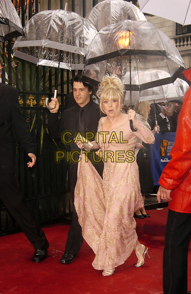 BARBARA WINDSOR.The British Academy Televison Awards at the Grosvenor House Hotel, Park Lane, London.full length, full-length, baftas, umbrella, pink dress, embroidered.www.capitalpictures.com.sales@capitalpictures.com.©Capital Pictures
