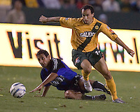 Landon Donovan of the LA Galaxy works the ball past David Ben-Dayan  of the Colorado Rapids at the Home Depot Center in Carson, CA on September 10, 2005.  (Photo by Brooks Parkenridge/ISI)