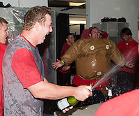Pawtucket Red Sox pitcher Brock Huntzinger #16 (left) celebrates in the locker room with J.C. Linares in the sumo suit after game four of a best of five playoff series against the Empire State Yankees at Frontier Field on September 8, 2012 in Rochester, New York.  Pawtucket defeated Empire State 7-1 to advance to the International League Finals.  (Mike Janes/Four Seam Images)
