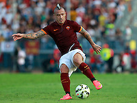 "Calcio, Serie A: Empoli vs Roma. Empoli, stadio ""Carlo Castellani"" 13 settembre 2014. <br /> Roma midfielder Radja Nainggolan, of Belgium, in action during the Italian Serie A football match between Empoli and AS Roma at Empoli's ""Carlo Castellani"" stadium, 13 September 2014.<br /> UPDATE IMAGES PRESS/Isabella Bonotto"