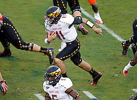 Maryland Terrapins quarterback Perry Hills (11) runs the ball for a touchdown during the game against Virginia in Charlottesville, Va. Maryland defeated Virginia 27-20.