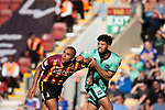 The home team captain James Vaughan is challenged by ex-home team defender Nathaniel Knight-Percival during the first-half as Bradford City played Carlisle United in a Skybet League 2 fixture at Valley Parade. The home team were looking to bounce back after being relegated during a disastrous 2018-19 season on and off the pitch. Bradford won the match 3-1, watched by a crowd of 14, 217.