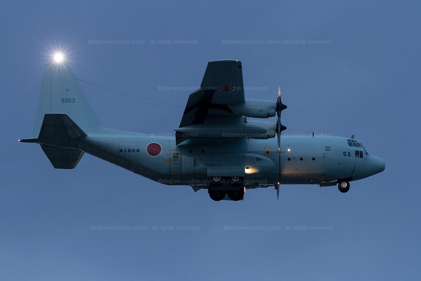 A Lockheed C130 Hercules transport aircraft with the Japanese Maritime Self Defence Force flying low near Naval Air facility, Atsugi airbase, Yamato, Kanagawa, Japan.Thursday May9th 2019