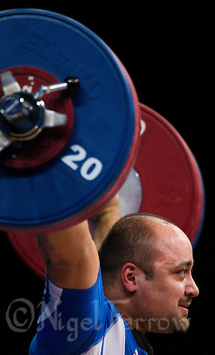 11 DEC 2011 - LONDON, GBR - Ferenc Gyurkovics (HUN) lifts during the men's +105kg category Snatch during the London International Weightlifting Invitational and 2012 Olympic Games test event held at the ExCel Exhibition Centre in London, Great Britain .(PHOTO (C) NIGEL FARROW)