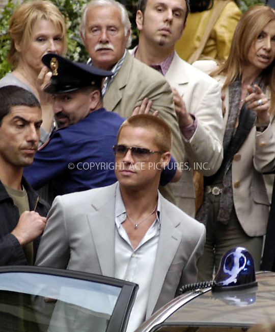 ** U.S. SALES ONLY!! **..BRAD PITT on the set of 'Ocean's 12' in Rome. Pitt, who in the movie plays Rusty Ryan, got arrested in one of the scenes and was seen lighting up a cigarette while on a break from filming. Rome, Italy, June 2, 2004. Please byline: RO001/ACE Pictures.   .. *** ***  ..All Celebrity Entertainment, Inc:  ..contact: Alecsey Boldeskul (646) 267-6913 ..Philip Vaughan (646) 769-0430..e-mail: info@nyphotopress.com