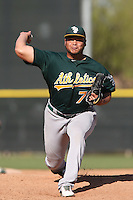 Jose Flores #70 of the Oakland Athletics pitches during a Minor League Spring Training Game against the Los Angeles Angels at the Los Angeles Angels Spring Training Complex on March 17, 2014 in Tempe, Arizona. (Larry Goren/Four Seam Images)