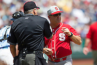 North Carolina State head coach Elliott Avent argues with the home plate umpire during Game 3 of the 2013 Men's College World Series between the North Carolina State Wolfpack and North Carolina Tar Heels at TD Ameritrade Park on June 16, 2013 in Omaha, Nebraska. The Wolfpack defeated the Tar Heels 8-1. (Andrew Woolley/Four Seam Images)