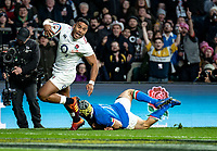 Manu Tuilagi of England slips the tackle of Angelo Esposito of Italy  to score his 2nd try during the Guinness Six Nations match between England and Italy at Twickenham Stadium on March 9th, 2019 in London, United Kingdom. Photo by Liam McAvoy.