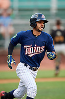 Elizabethton Twins center fielder Gilberto Celestino (25) runs to first base during a game against the Bristol Pirates on July 29, 2018 at Joe O'Brien Field in Elizabethton, Tennessee.  Bristol defeated Elizabethton 7-4.  (Mike Janes/Four Seam Images)
