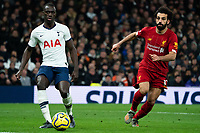 Tottenham's Davinson Sanchez plays the ball back despite the attentions of Liverpool's Mohamed Salah <br /> <br /> Photographer Stephanie Meek/CameraSport<br /> <br /> The Premier League - Tottenham Hotspur v Liverpool - Saturday 11th January 2020 - Tottenham Hotspur Stadium - London<br /> <br /> World Copyright © 2020 CameraSport. All rights reserved. 43 Linden Ave. Countesthorpe. Leicester. England. LE8 5PG - Tel: +44 (0) 116 277 4147 - admin@camerasport.com - www.camerasport.com