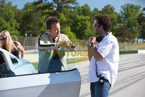 Scott Waugh (Director), Aaron Paul<br /> on the set of Need for Speed (2014) <br /> *Filmstill - Editorial Use Only*<br /> CAP/NFS<br /> Image supplied by Capital Pictures