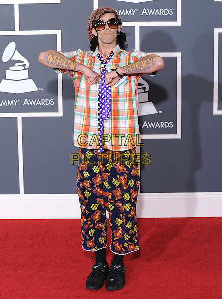 MUCK STICKY (born Justin M. Osburn).Arrivals at the 52nd Annual GRAMMY Awards held at The Staples Center in Los Angeles, California, USA..January 31st, 2010.grammys full length cropped trousers pattern print fashion disaster shirt white purple tie orange hat arms tattoo sunglasses shades .CAP/RKE/DVS.©DVS/RockinExposures/Capital Pictures