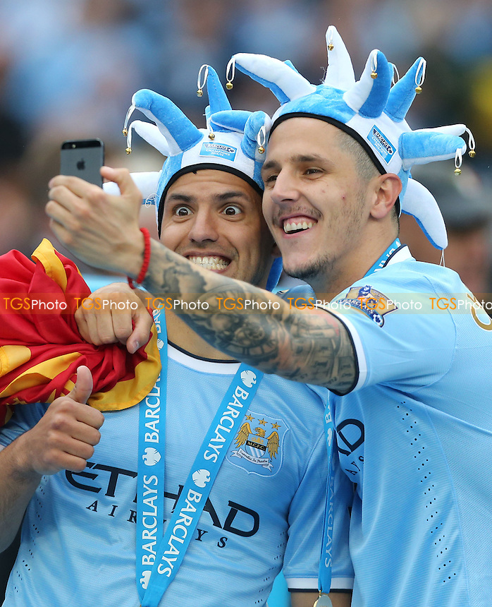 Stevan Jovatic and Sergio Aguero do a selfie during the celebrations - Manchester City vs West Ham United, Barclays Premier League at the Etihad Stadium, Manchester - 11/05/14 - MANDATORY CREDIT: Rob Newell/TGSPHOTO - Self billing applies where appropriate - 0845 094 6026 - contact@tgsphoto.co.uk - NO UNPAID USE