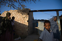 """Koos Aw Dahir - 40, right, and Siida Noor Ahmed, left..Has been living in State House since 1992 .11 children - oldest, 22, youngest, 3.Koos looks after four of Siida's children..Siida fled mogadishu after she lost her husband and 3 children in the onging war...""""I have 11 children and my own problems, but I was touched by the problems of Siida.  I fled Somaliland during the 1988 war in Somalia so I know the problems of a refugee.  I cannot forget the war.  There was fighting, bullets.  Our men were being slaughtered in front of us like goats.  When we fled, we were afraid of wild animals.  Hyenas are around during war - they like the taste of human flesh.""""  ..""""When people first arrive, they are very afraid. They still have the feeling of where they've come from.  When I look at them, it's like looking at people running out of a burning house.  The new families who come here have nothing so they rely on us.""""  .. """"When it was built, State House was very beautiful.  I never went in and saw it, the closest you could get was the gate.  But people who'd seen inside used to tell stories, it was marvelous.  .There are so many problems here now though.  There is no water, no medical centre, no playgrounds for the children."""".  .""""I want the international community to look with a kind eye on the community living in State House.  Already we are displaced in our own country with no water, education, health services.  At the same time, we have another group of refugees adding to our problems.""""."""