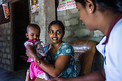 Mathumita (right) speaks with Sugandhini (30) and her 9 month daughter, Rutsika during the field visits in Punaineeravi village in Kilinochchi in Northern Sri Lanka. Photo: Sanjit Das/Panos