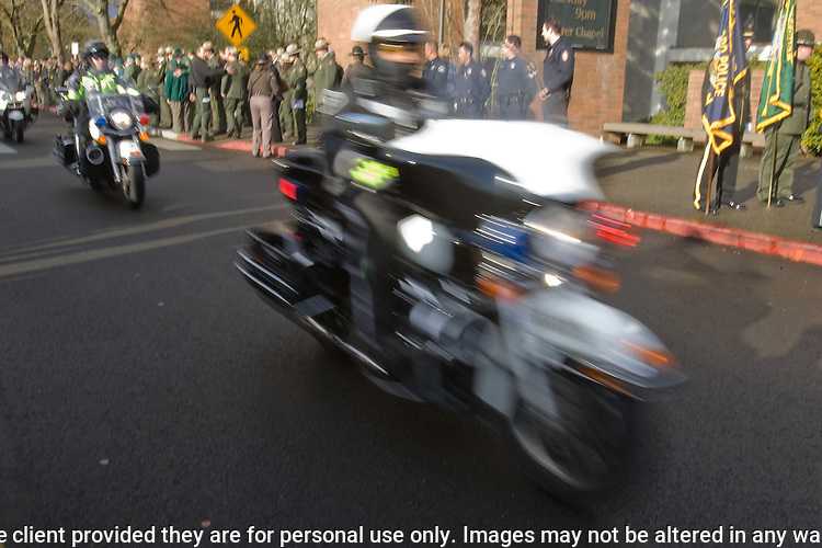 Law Enforcement motorcycles drive in the procession during memorial services for National Park Service Ranger Margaret Anderson at the Pacific Lutheran University in Tacoma on January 10, 2010.  Anderson, was slain at Mount Rainier on New Years' Day when she set up a road block to intercept a vehicle, driven by Benjamin Barnes, who failed to stop at a chain-up checkpoint.  Barnes, the suspect  in the shooting was found dead was found dead the next day. He had drown in Paradise Creek. ©2012. Jim Bryant Photo. All RIGHTS RESERVED.