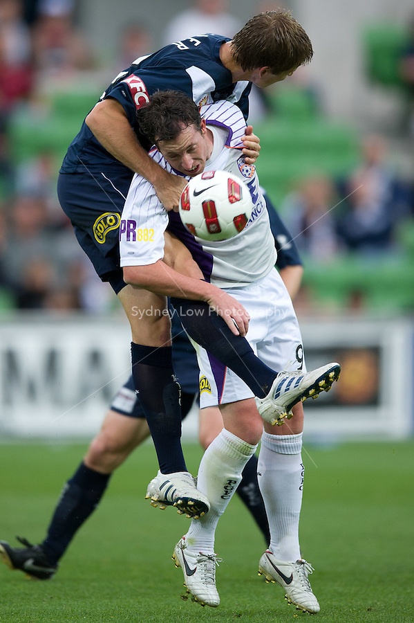MELBOURNE, AUSTRALIA - DECEMBER 18: Adrian Leijer of the Victory and Robbie Fowler of the Glory compete for the ball during the round 19 A-League match between the Melbourne Victory and the Perth Glory at AAMI Park on December 18, 2010 in Melbourne, Australia.  (Photo by Sydney Low / Asterisk Images)