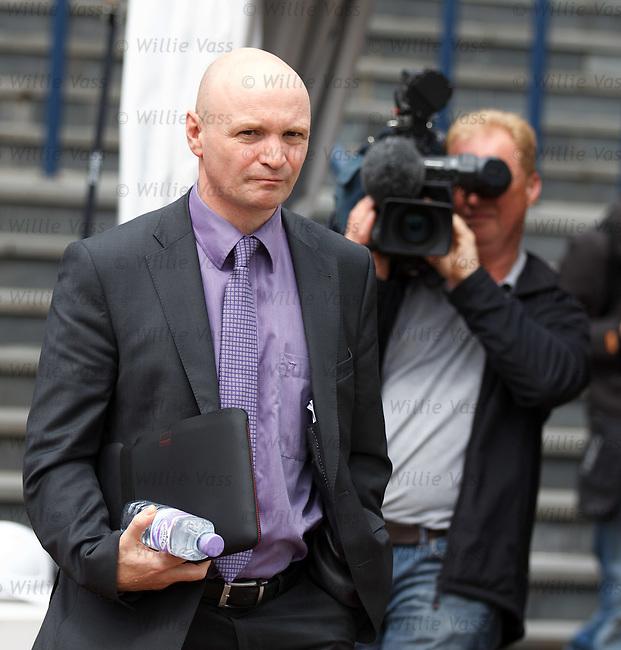 Dundee Utd chairman Stephen Thompson leaving today's SPL AGM at Hampden