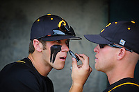Jun. 1, 2010; Grand Junction, CO, USA; Southern Nevada Coyotes right fielder Bryce Harper (left) uses the reflection off the sunglasses of a teammate as he applies eye black prior to the game against Iowa Western C.C. during the Junior College World Series as Suplizio Field. Southern Nevada won the game 12-7. Mandatory Credit: Mark J. Rebilas-