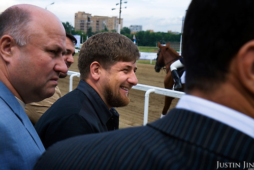 """Chechen President Ramzan Kadyrov attends a horse race in Moscow's Hippodrome. .Kadyrov's horse, """"Royal Quiet"""", came first in the 1600-metre race. .The horse, born in the U.S.A., is parented by father: Real Quiet, mother: Dinasoar, is trained by S. G. Kolesnikov and rode by master jockey S. V. Petin."""