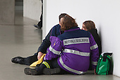 MSV Arena, Duisburg, North Rhine-Westphalia, Germany - A young woman is looked after members of an emergency service after collapsing at the event. A commemorative service is held on the 1st anniversary of the Loveparade tragedy in which 21 young people lost their lives and hundreds were injured as they tried to get to the event to celebrate life, love and music; to date, politicians, organisers and police still try to apportion blame, Photo Credit: Bettina Strenske