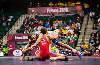 Jordan Burroughs of the United States (cq, in blue), wrestles Carlos Arturo Izquierdo Mendez of Colombia in the final round of the Pan American Championships at Dr. Pepper Arena in Frisco, Texas, Saturday, February 27, 2015. Burroughs went on to win the match 12-2 and also win gold at the event.<br /> <br /> Photo by Matt Nager