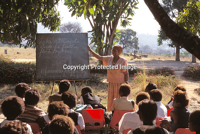 EDPRIMA19115.Education. Primary. Mutale. Tshandama Primary School. Ernistene Wilson, 58 yr old. Peace Corps Volunteer, teaching an outdoor class. She completed a Doctorate in African - Amerian teachers. .©Per - Anders Pettersson / iAfrika Photos