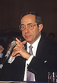 In this file photo from February 23, 1988, then-Governor Mario Cuomo (Democrat of New York) adjusts his tie as he testifies before the United States Senate Committee on Labor and Human Resources in Washington, D.C. Cuomo passed away in New York, New York on January 1, 2015 at age 82.<br /> Credit: Arnie Sachs / CNP
